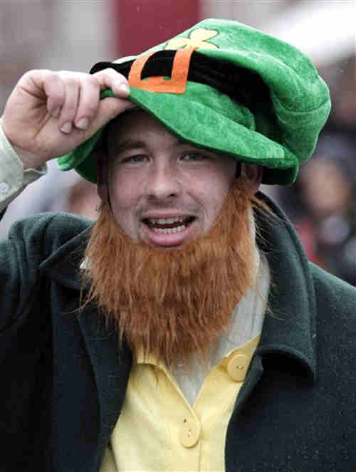 A man dressed as a leprechaun takes part in the St Patrick's parade in Armagh, Northern Ireland, Saturday, March 17, 2012. (AP Photo/Peter Morrison)