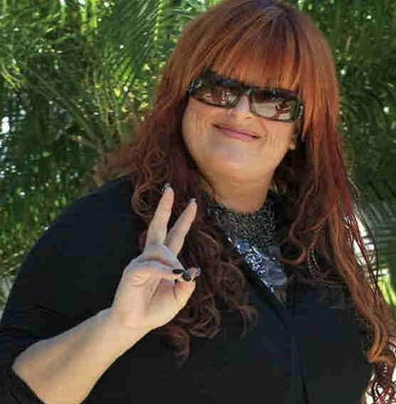 Singer Wynonna Judd flashes the &#34;peace&#34; symbol as she leaves the funeral for IndyCar driver Dan Wheldon, Saturday, Oct 22, 2011, in St. Petersburg, Fla. Wheldon was killed Sunday, Oct. 16, 2011, in a fiery 15-car crash at the Las Vegas Motor Speedway. Judd sang two songs during the service. <span class=meta>( &#40;AP Photo&#47;Chris O&#39;Meara&#41;)</span>