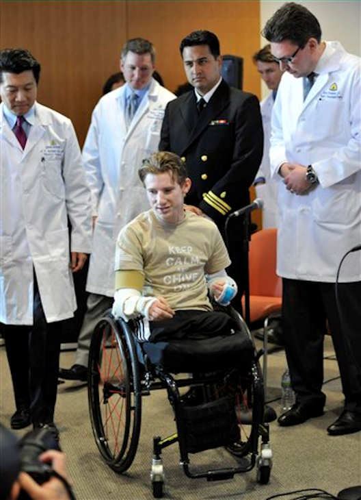 "<div class=""meta ""><span class=""caption-text "">Retired Infantryman Brendan M. Marrocco wheels himself into a news conference followed by surgeons, from left, W.P. Andrew Lee, M.D., Jamie Shores M.D., Patrick L. Basile M.D. and Gerald Brandacher M.D. Tuesday, Jan. 29. 2013 at Johns Hopkins hospital in Baltimore. Marrocco received a transplant of two arms from a deceased donor after losing all four limbs in a 2009 roadside bomb attack in Iraq. (AP Photo/Gail Burton)</span></div>"