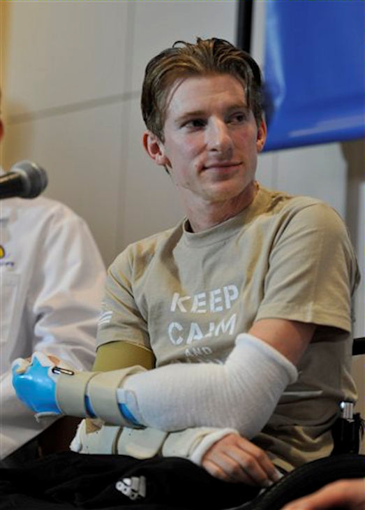 Retired Infantryman Brendan M. Marrocco listens during a news conference Tuesday, Jan. 29. 2013 at Johns Hopkins hospital in Baltimore. Marrocco received a transplant of two arms from a deceased donor after losing all four limbs in a 2009 roadside bomb attack in Iraq. <span class=meta>(AP Photo&#47;Gail Burton)</span>