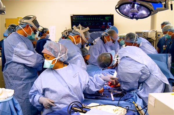 "<div class=""meta ""><span class=""caption-text ""> In a Dec. 18, 2012 photo provided by Johns Hopkins Medical, a surgical team at Johns Hopkins Hospital in Baltimore works on a double arm transplant for U.S. Army infantryman Brendan Marrocco, 26, who lost all four limbs in Iraq. The transplants are only the seventh double-hand or double-arm transplant ever conducted in the United States. The infantryman was injured by a roadside bomb in 2009. (AP Photo/Johns Hopkins Medical)</span></div>"