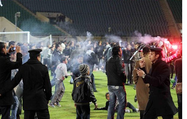 Egyptian fans rush into the field following Al-Ahly club soccer match against Al-Masry club at the soccer stadium in Port Said, Egypt Wednesday, Feb. 1, 2012.  <span class=meta>(AP Photo)</span>