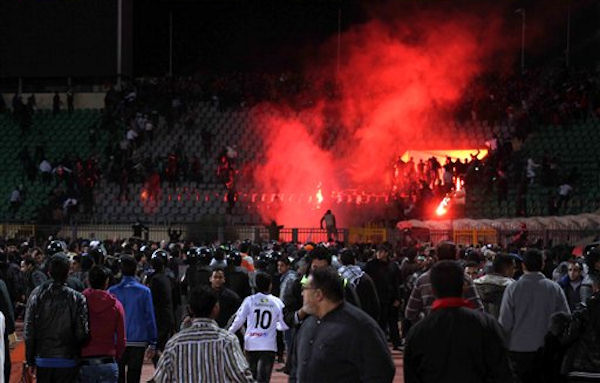 "<div class=""meta ""><span class=""caption-text "">Egyptian fans rush into the field following Al-Ahly club soccer match against Al-Masry club at the soccer stadium in Port Said, Egypt Wednesday, Feb. 1, 2012.  (AP Photo)</span></div>"