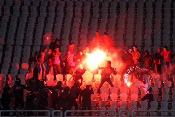 Egyptian fans clash with riot police following Al-Ahly club soccer match against Al-Masry club at the soccer stadium in Port Said, Egypt Wednesday, Feb. 1, 2012.  <span class=meta>(AP Photo)</span>