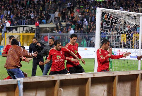 Team players of the Egyptian Al-Ahly club run for safety during clashes following their soccer match against Al-Masry club at the soccer stadium in Port Said, Egypt Wednesday, Feb. 1, 2012. <span class=meta>(AP Photo)</span>