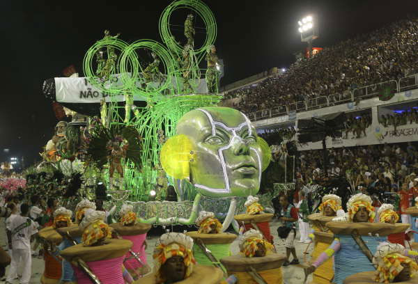 "<div class=""meta ""><span class=""caption-text "">Members of Grande Rio samba school parade during carnival celebrations at the Sambadrome in Rio de Janeiro, early Tuesday, Feb. 16, 2010.  ((AP Photo/Silvia Izquierdo))</span></div>"