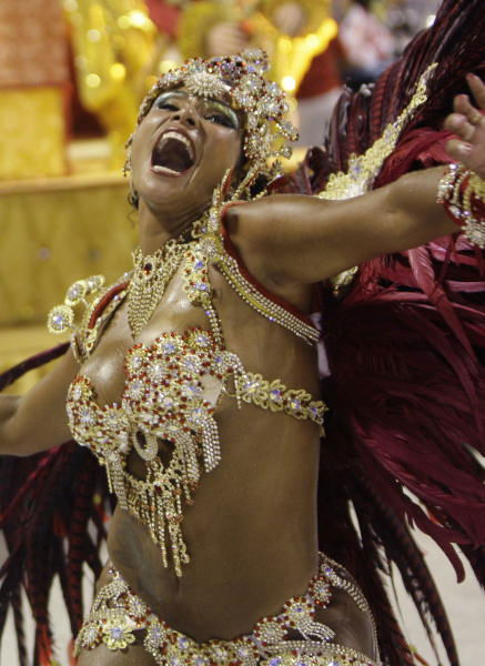 "<div class=""meta ""><span class=""caption-text "">A dancer of Porto da Pedra samba school performs during carnival parade at the Sambadrome in Rio de Janeiro, Monday, Feb.15, 2010.  ((AP Photo/Felipe Dana))</span></div>"