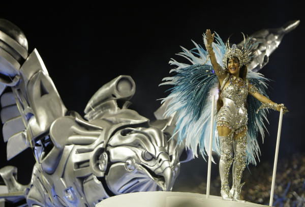 "<div class=""meta ""><span class=""caption-text "">A member of Portela samba school performs on a float during a carnival parade at the Sambadrome in Rio de Janeiro, Tuesday, Feb. 16, 2010. ( (AP Photo/Felipe Dana))</span></div>"