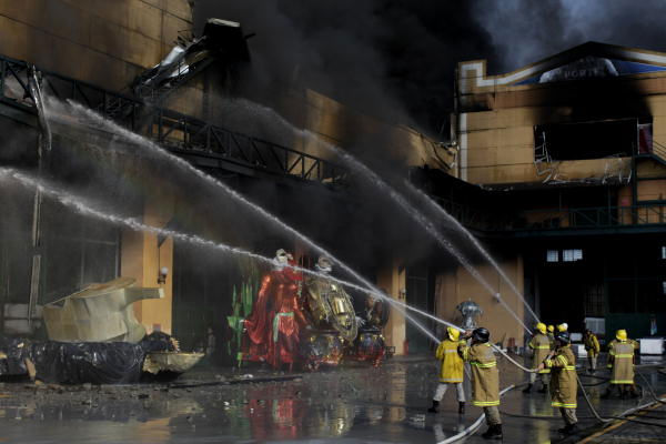 "<div class=""meta ""><span class=""caption-text "">Firefighters work to put out a fire at warehouses in Samba City, Rio de Janeiro, Brazil, Monday, Feb. 7, 2011. A massive fire consumed the warehouses where Rio de Janeiro's samba groups store the props and costumes for Brazil's largest Carnival parade. No injured were reported.  ((AP Photo/Felipe Dana))</span></div>"