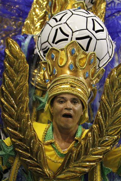 "<div class=""meta ""><span class=""caption-text "">A member of Grande Rio samba school parades during carnival celebrations at the Sambadrome in Rio de Janeiro, early Tuesday, Feb. 16, 2010.  ((AP Photo/Felipe Dana))</span></div>"