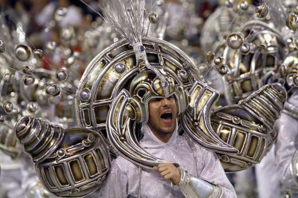 "<div class=""meta ""><span class=""caption-text "">A member of Portela samba school performs during a carnival parade at the Sambadrome in Rio de Janeiro, Tuesday, Feb. 16, 2010.  ((AP Photo/Silvia Izquierdo))</span></div>"