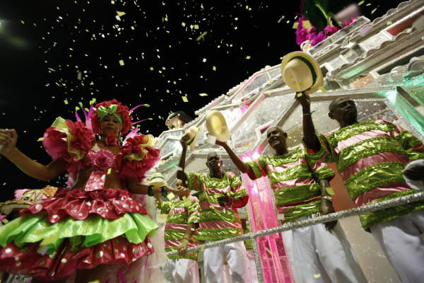 "<div class=""meta ""><span class=""caption-text "">Dancers of Mangueira samba school perform during carnival parade at the Sambadrome, in Rio de Janeiro, Tuesday, Feb.16, 2010.  ((AP Photo/Felipe Dana))</span></div>"