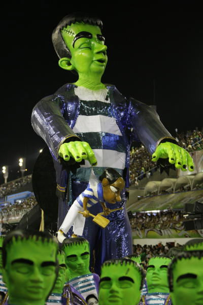 "<div class=""meta ""><span class=""caption-text "">Members of Vila Isabel samba school parade during carnival celebrations at the Sambadrome in Rio de Janeiro, early Tuesday, Feb. 16, 2010. ( (AP Photo/Felipe Dana))</span></div>"