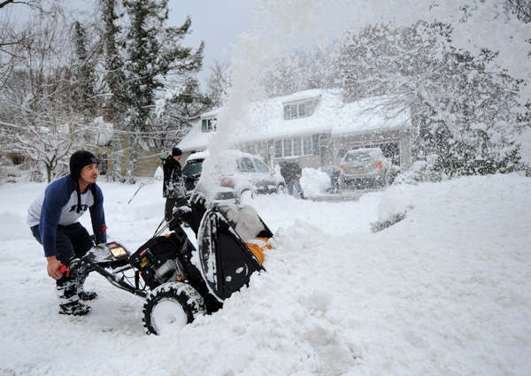Eguin Belasquez steers a snow blower through mounds of snow as he helps his friend dig out of his driveway after a snow storm on Saturday, Feb. 9, 2013 in Sea Cliff, N.Y. &#40;AP Photo&#47;Kathy Kmonicek&#41;   <span class=meta>(AP Photo&#47;Kathy Kmonicek)</span>