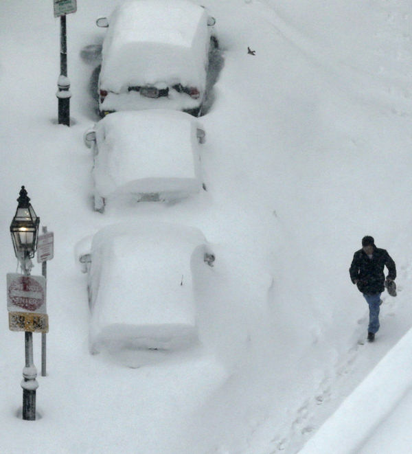 "<div class=""meta ""><span class=""caption-text "">A man walks past snow covered cars in the South End neighborhood of Boston, Saturday, Feb. 9, 2013. The Boston area received about two feet of snow from a winter storm. (AP Photo/Charles Krupa)   (AP Photo/Charles Krupa)</span></div>"