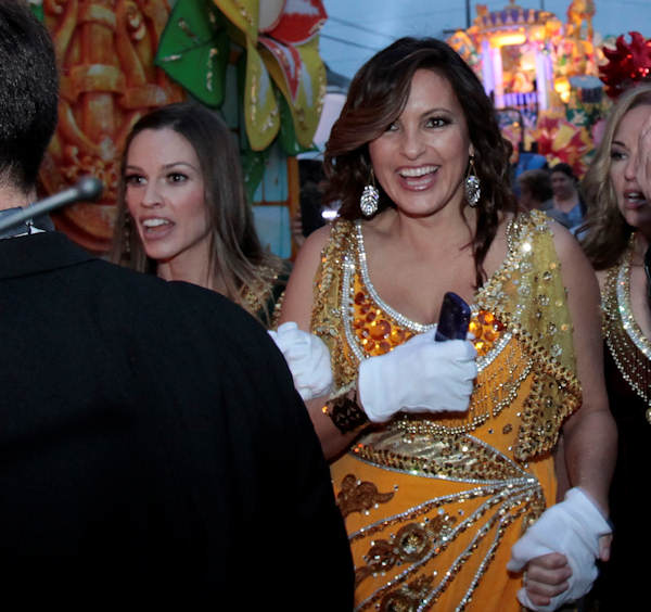 Actress Mariska Hargitay, right and Hillary Swank arrive at their float in the staging area of the Mardi Gras parade in New Orleans, Monday, Feb. 20, 2012. (AP Photo/Bill Haber)