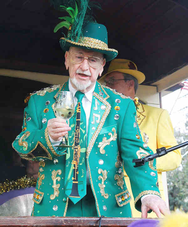 Pete Fountain makes a toast to start the day long celebration of Mardi Gras while leading his Pete Fountain's Half Fast Walking Club on its trek through the streets of New Orleans, Tuesday, Feb. 21, 2012. This is the last day of the Mardi Gras celebration ending at midnight, after a day long celebration of parades, marching groups and people in costumes. (AP Photo/Bill Haber)