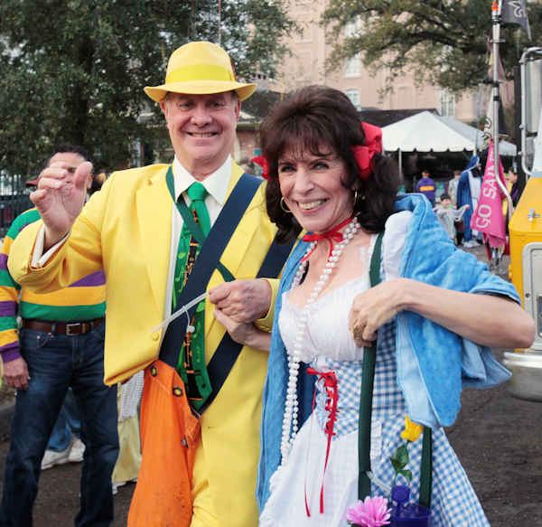 Larry Zimmer and his wife Charlotte Zimmer march down St. Charles Ave. with Pete Fountain's Half Fast Marching Club as it begins to parade through the streets of New Orleans, Tuesday, Feb. 21, 2012. This is the last day of the Mardi Gras celebration ending at midnight, after a day long celebration of parades, marching groups and people in costumes. (AP Photo/Bill Haber)