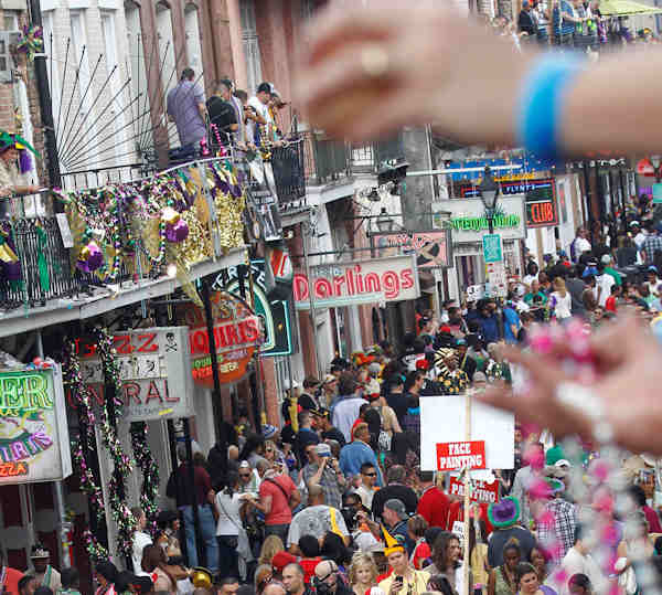 Mardi Gras revelers jam Bourbon Street in the French Quarter of New Orleans, Tuesday, Feb. 21, 2012. This is the last day of the Mardi Gras celebration ending at midnight, after a day long celebration of parades, marching groups and people in costumes. (AP Photo/Bill Haber)
