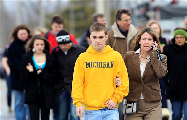 Students leave with parents from Maple Elementary School after a shooting at Chardon High School Monday, Feb. 27, 2012, in Chardon, Ohio. Students assembled at Maple Elementary School after a shooting took place at the high school. <span class=meta>(AP Photo&#47;Tony Dejak)</span>