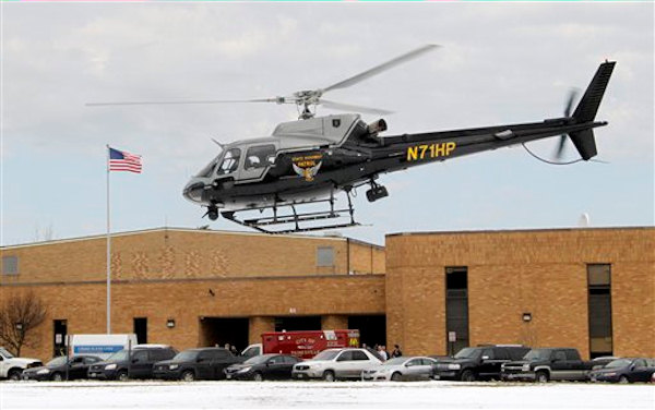 An Ohio Highway Patrol helicopter takes off from the rear of Chardon High School in Chardon, Ohio Monday, Feb. 27, 2012.  <span class=meta>(AP Photo&#47;Mark Duncan)</span>