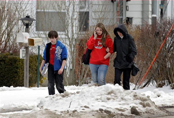 A woman and her children walk down a back street near Chardon High School in Chardon, Ohio Monday, Feb. 27, 2012.  <span class=meta>(AP Photo&#47;Mark Duncan)</span>