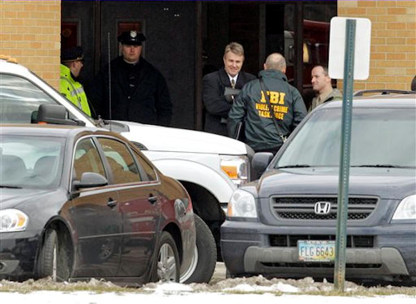 Investigators congregate at a rear entrance to Chardon High School in Chardon, Ohio Monday, Feb. 27, 2012.  <span class=meta>(AP Photo&#47;Mark Duncan)</span>