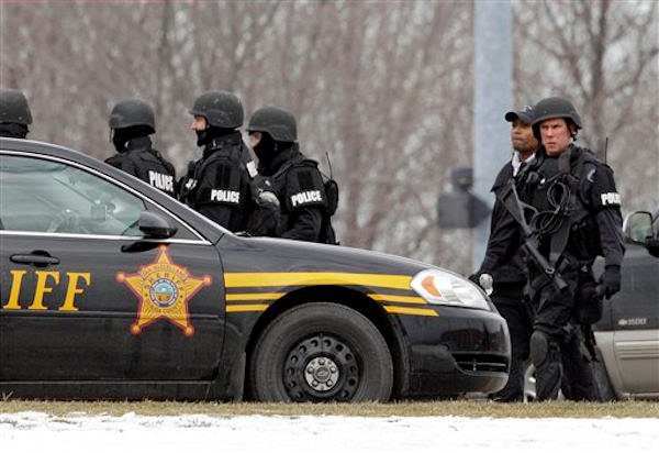 S.W.A.T. members leave Chardon High School in Chardon, Ohio Monday, Feb. 27, 2012. <span class=meta>(AP Photo&#47;Mark Duncan)</span>