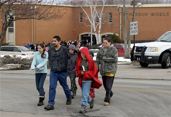 Parents take their children from Chgardon Middle School in Chardon, Ohio Monday, Feb. 27, 2012. Students were released after a gunman opened fire inside the nearby high school&#39;s cafeteria at the start of the school day Monday. <span class=meta>(AP Photo&#47;Mark Duncan)</span>