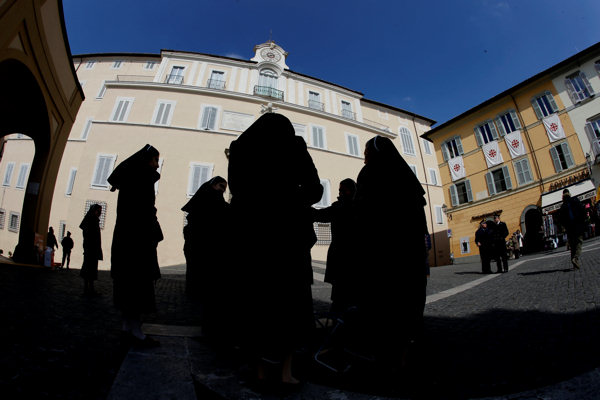 Nuns stand in front of the pope&#39;s summer residence, building in the background, in Castel Gandolfo, south of Rome, Thursday, Feb. 28, 2013. Shortly before 5 p.m. on Thursday, Benedict will leave the Apostolic palace inside the Vatican for the last time as pontiff, head to the helipad at the top of the hill in the Vatican gardens and fly to the papal retreat at Castel Gandolfo south of Rome. There, at 8 p.m. sharp, Benedict will become the first pontiff in 600 years to resign. &#40;AP Photo&#47;Andrew Medichini&#41;   <span class=meta>(AP Photo&#47;Andrew Medichini)</span>