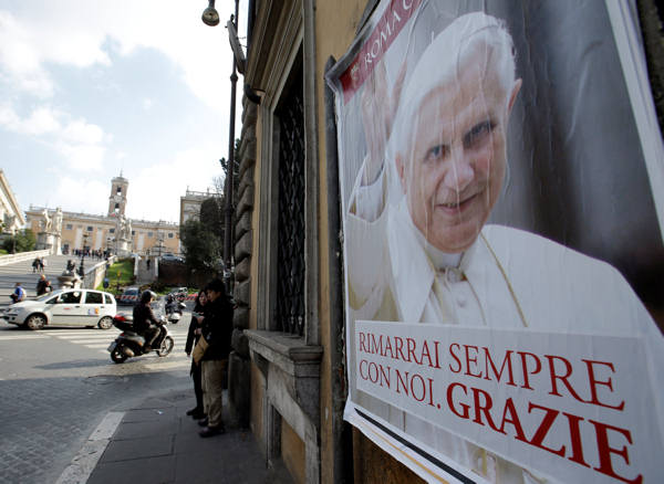 A poster of Pope Benedict XVI with writing reading in Italian,&#34; You will stay always with us. Thank you&#34; is seen near Rome&#39;s Capitol Hill, Thursday, Feb. 28, 2013. Shortly before 5 p.m. on Thursday, Benedict will leave the Apostolic palace inside the Vatican for the last time as pontiff, head to the helipad at the top of the hill in the Vatican gardens and fly to the papal retreat at Castel Gandolfo south of Rome. There, at 8 p.m. sharp, Benedict will become the first pontiff in 600 years to resign. &#40;AP Photo&#47;Gregorio Borgia&#41;   <span class=meta>(AP Photo&#47;Vatican TV)</span>