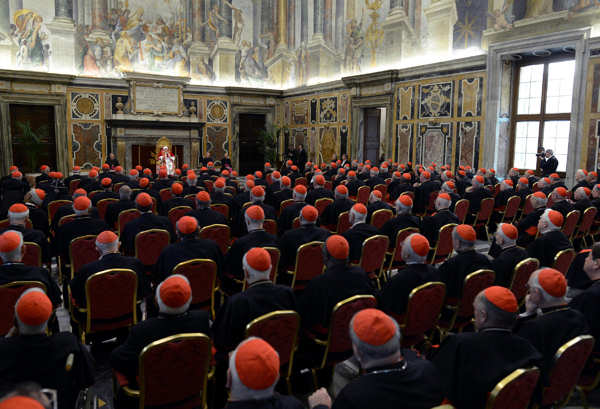 In this photo provided by the Vatican newspaper L&#39;Osservatore Romano, Pope Benedict XVI, top center, delivers his message on the occasion of his farewell meeting to cardinals, at the Vatican, Thursday, Feb. 28, 2013. Benedict XVI promised his &#34;unconditional reverence and obedience&#34; to his successor in his final words to his cardinals Thursday, a poignant farewell before he becomes the first pope in 600 years to resign. &#40;AP Photo&#47;L&#39;Osservatore Romano, ho&#41;   <span class=meta>(AP Photo&#47;L&#39;Osservatore Romano, ho)</span>