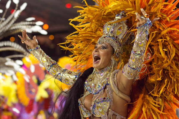 A dancer performs during the parade of Nene de Vila Matilde samba school in Sao Paulo, Brazil, Saturday March 5, 2011.  <span class=meta>(AP Photo&#47;Andre Penner)</span>