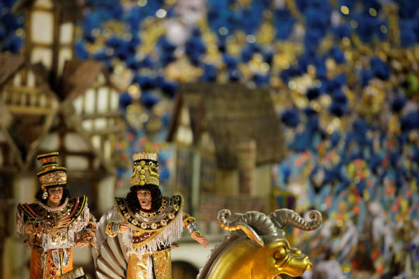 Vila Isabel samba school dancers perform during a carnival parade in the Sambadrome in Rio de Janeiro, Brazil, early Monday March 7, 2011. <span class=meta>(AP Photo&#47;Felipe Dana)</span>
