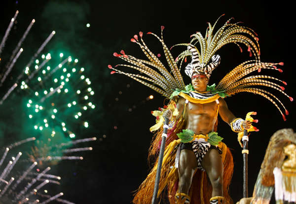 A dancer from the Imperatriz Leopoldinense samba school parades during Carnival celebrations at the Sambadrome in Rio de Janeiro, Brazil, Sunday March 6, 2011.  <span class=meta>(AP Photo&#47;Rodrigo Abd)</span>