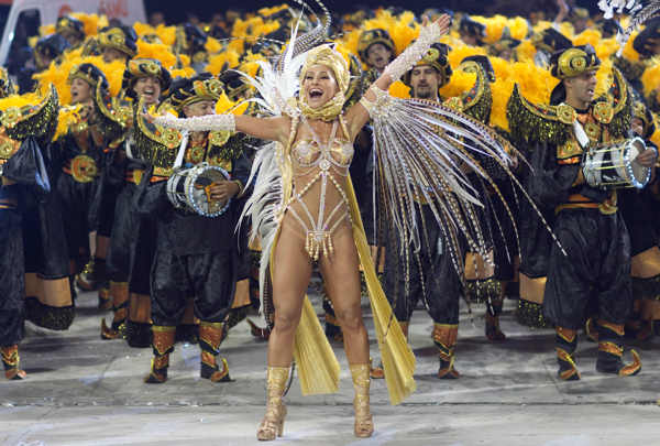 Comedian Sabrina Sato performs during the parade of Gavioes da Fiel samba school in Sao Paulo, Brazil, Sunday March 6, 2011. <span class=meta>(AP Photo&#47;Andre Penner)</span>