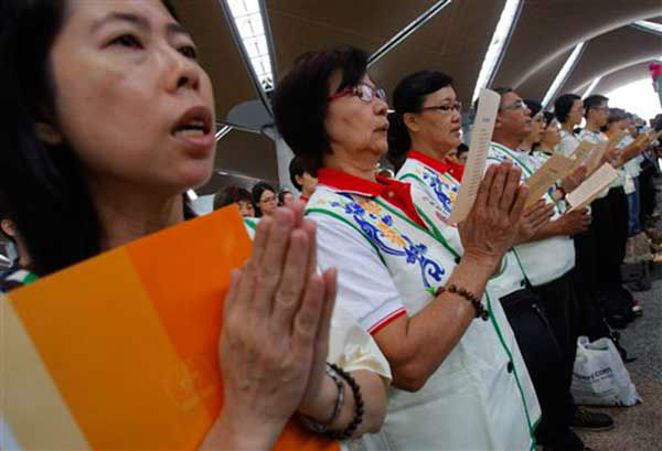 Members of Young Buddhist Association of Malaysia offer a special prayer for passengers aboard a missing plane, at Kuala Lumpur International Airport in Sepang, Malaysia, Sunday, March 9, 2014. Military radar indicates that the missing Boeing 777 jet of Malaysia Airlines may have turned back, Malaysia?s air force chief said Sunday as scores of ships and aircraft from across Asia resumed a hunt for the plane and its 239 passengers. &#40;AP Photo&#47;Lai Seng Sin&#41; <span class=meta>(Photo&#47;Lai Seng Sin)</span>