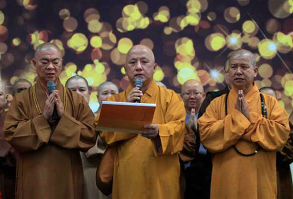 Buddhist monks offer a special prayer for passengers aboard a missing plane, at Kuala Lumpur International Airport in Sepang, Malaysia, Sunday, March 9, 2014. Military radar indicates that the missing Boeing 777 of Malaysia Airlines may have turned back, Malaysia?s air force chief said Sunday as scores of ships and aircraft from across Asia resumed a hunt for the plane and its 239 passengers. &#40;AP Photo&#47;Lai Seng Sin&#41; <span class=meta>(Photo&#47;Lai Seng Sin)</span>