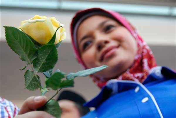 A member of youth group holds a rose as she prays for the missing Malaysia Airlines plane outside a hotel in Putrajaya, Malaysia, Monday, March 10, 2014. Vietnamese aircraft spotted what they suspected was one of the doors of the missing Boeing 777 on Sunday, while questions emerged about how two passengers managed to board the ill-fated aircraft using stolen passports. &#40;AP Photo&#47;Lai Seng Sin&#41; <span class=meta>(Photo&#47;Lai Seng Sin)</span>