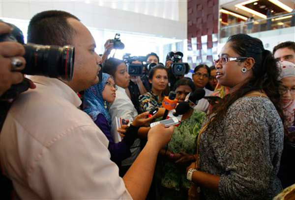 A family member of passengers aboard a missing Malaysia Airlines plane speaks to journalists at a hotel in Putrajaya, Malaysia, Monday, March 10, 2014. Vietnamese aircraft spotted what they suspected was one of the doors of the missing Boeing 777 on Sunday, while questions emerged about how two passengers managed to board the ill-fated aircraft using stolen passports. &#40;AP Photo&#47;Lai Seng Sin&#41; <span class=meta>(Photo&#47;Lai Seng Sin)</span>
