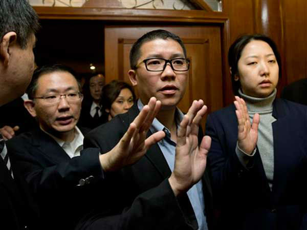CEO of Malaysia Airlines Ignatius Ong, center, gestures as he prepares to speak to the media outside a hotel room for relatives or friends of passengers aboard a missing Malaysia Airlines airplane in Beijing, China Monday, March 10, 2014. Vietnamese aircraft spotted what they suspected was one of the doors of the missing Boeing 777 on Sunday, while questions emerged about how two passengers managed to board the ill-fated aircraft using stolen passports. &#40;AP Photo&#47;Andy Wong&#41; <span class=meta>(Photo&#47;Andy Wong)</span>