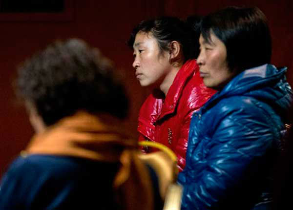 "<div class=""meta image-caption""><div class=""origin-logo origin-image ""><span></span></div><span class=""caption-text"">Chinese relatives of passengers aboard a missing Malaysia Airlines plane wait inside a hotel room in Beijing Monday, March 10, 2014. The anguished hours had turned into a day and a half. Fed up with awaiting word on the missing plane, relatives of passengers in Beijing lashed out at the carrier with a handwritten ultimatum and an impromptu news conference. (AP Photo/Andy Wong) (Photo/Andy Wong)</span></div>"