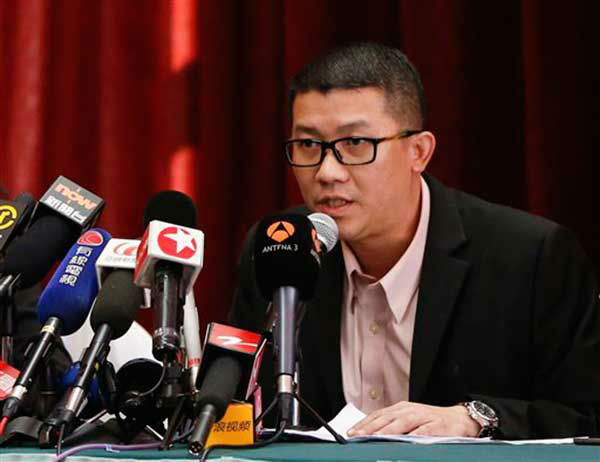 "<div class=""meta ""><span class=""caption-text "">Ignatius Ong, right, executive official from Malaysia Airline speaks during a press conference in Beijing, China, Sunday, March 9, 2014. Military radar indicates that the airline's missing Boeing 777 jet may have turned back, Malaysia's air force chief said Sunday as scores of ships and aircraft from across Asia resumed a hunt for the plane and its 239 passengers. (AP Photo/Vincent Thian) (Photo/Vincent Thian)</span></div>"