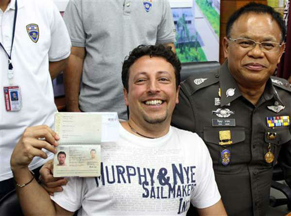 "<div class=""meta image-caption""><div class=""origin-logo origin-image ""><span></span></div><span class=""caption-text"">Italian Luigi Maraldi, left, whose stolen passport was used by a passenger boarding a missing Malaysian airliner, shows his passport as he reports himself to Thai police at Phuket police station in Phuket province, southern Thailand Sunday, March 9, 2014. Maraldi spoke at a police news conference where he showed his current passport, which replaced the stolen one, and expressed surprise that anyone could use his old one. (AP Photo/Krissada Muanhawang) (Photo/Krissada Muanhawong)</span></div>"