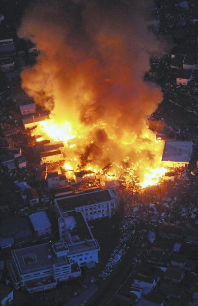 Flames rise from houses on fire after powerful earthquakes hit Yamada, Iwate Prefecture, northern Japan, Friday, March 11, 2011.  <span class=meta>(AP Photo&#47;Osamu Kanazawa, The Yomiuri Shimbun)</span>