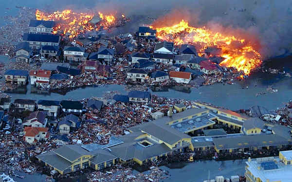 "<div class=""meta image-caption""><div class=""origin-logo origin-image ""><span></span></div><span class=""caption-text"">Houses are in flame while the Natori river is flooded over the surrounding area by tsunami tidal waves in Natori city, Miyagi Prefecture, northern Japan, March 11, 2011, after strong earthquakes hit the area.  (AP Photo/Yasushi Kanno, The Yomiuri Shimbun)</span></div>"