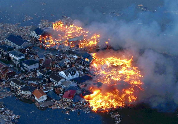 Houses are in flame while the Natori river is flooded over the surrounding area by tsunami tidal waves in Natori city, Miyagi Prefecture, northern Japan, March 11, 2011, after strong earthquakes hit the area.  <span class=meta>(AP Photo&#47;Yasushi Kanno, The Yomiuri Shimbun)</span>