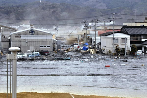 A tsunami tidal wave washes away houses in Kesennuma, Miyagi Prefecture, Friday, March 11, 2011 after strong earthquakes hit the area.  <span class=meta>(AP Photo&#47;Keichi Nakane, The Yomiuri Shimbun)</span>