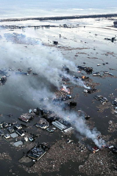 An aerial view shows houses burning and the Natori River flooded over the surrounding area in Natori, northern Japan, Friday, March 11, 2011. The largest earthquake in Japan&#39;s recorded history slammed the eastern coasts Friday.  <span class=meta>(AP Photo&#47;Yasushi Kanno, The Yomiuri Shimbun)</span>
