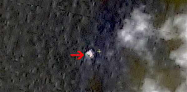 In this March 9, 2014 satellite image seen on the website of the Chinese State Administration of Science, Technology and Industry for National Defense, floating objects are seen at sea next to the red arrow which was added by the source.  China&#39;s Xinhua News Agency reported that the images show suspected debris from the missing Malaysia Airlines jetliner floating off the southern tip of Vietnam.  It turned out to be a false lead. <span class=meta>(AP Photo&#47;Chinese State Administration of Science, Technology and Industry for National Defense)</span>